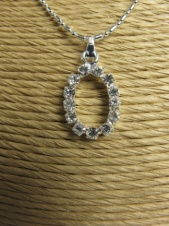 Silver Effect Fashion Necklace with Sparkling Crystal Initial ''O'' Pendant